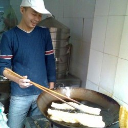 Chinese breakfast: Dough stick (yóu tiáo-油条) with soy bean milk (dòu jiāng-豆浆)